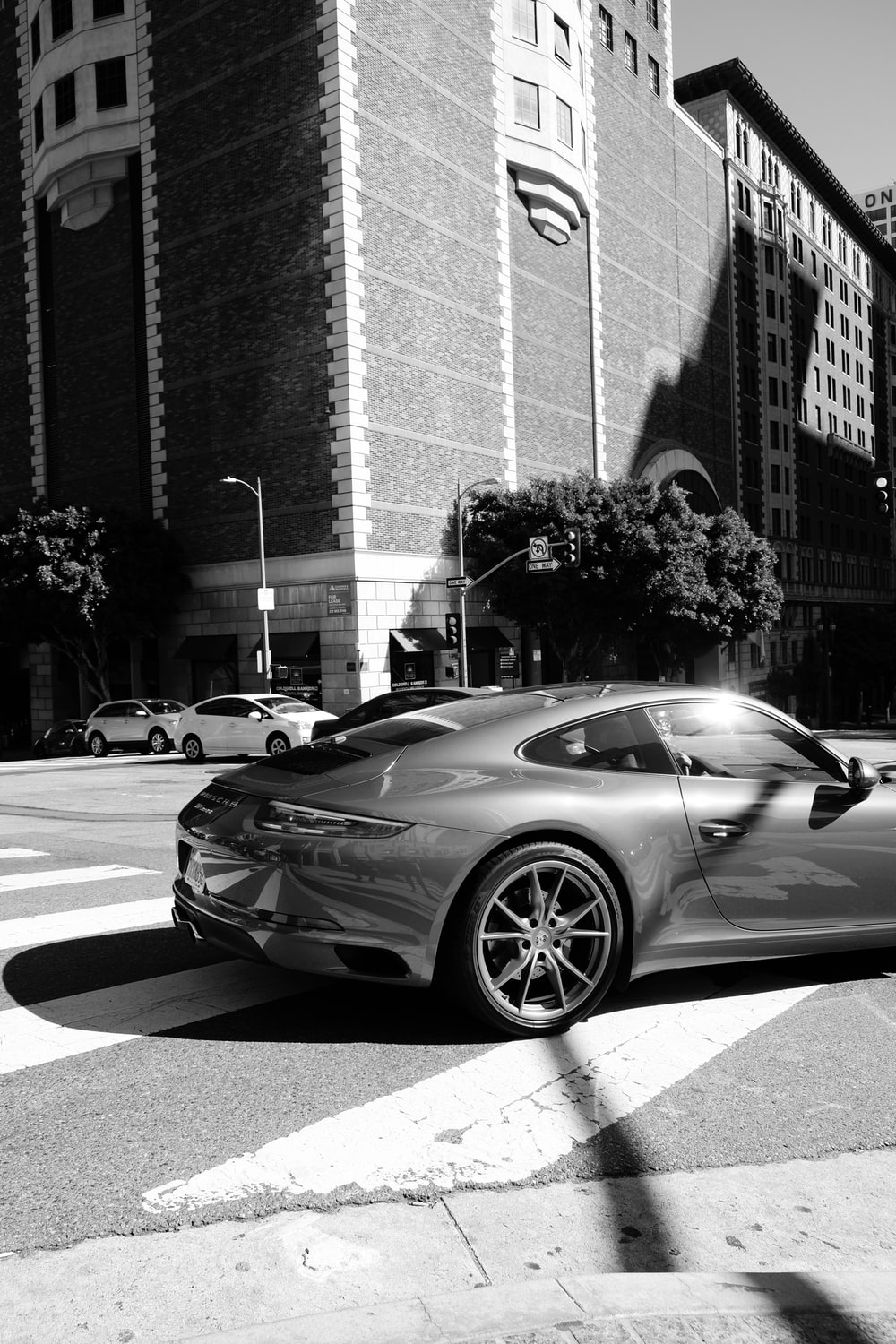 grayscale photography of vehicle on road