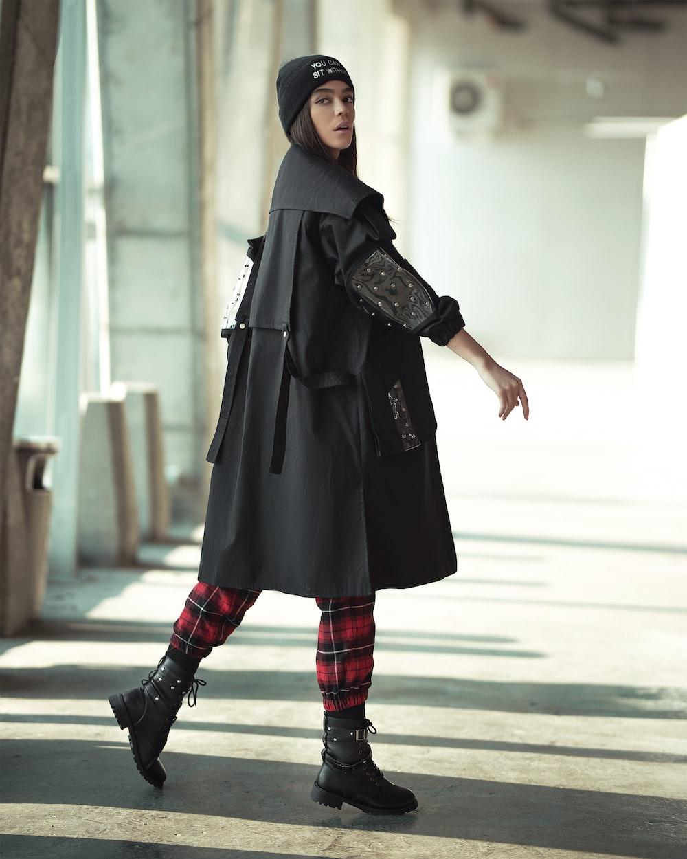 person wearing black coat