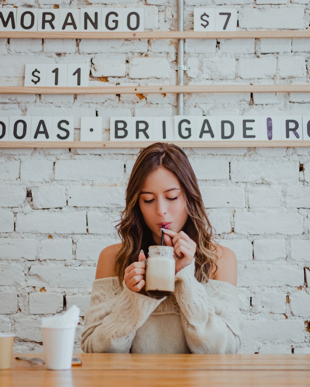 woman sipping on beverage