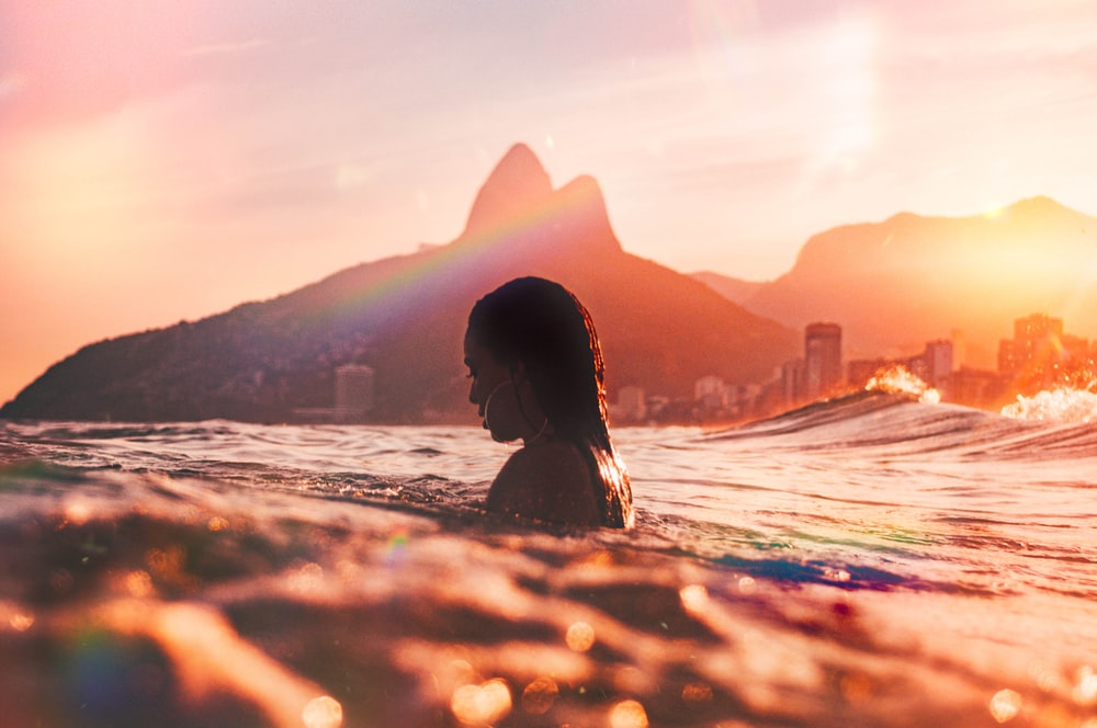 woman swimming on the ocean photography