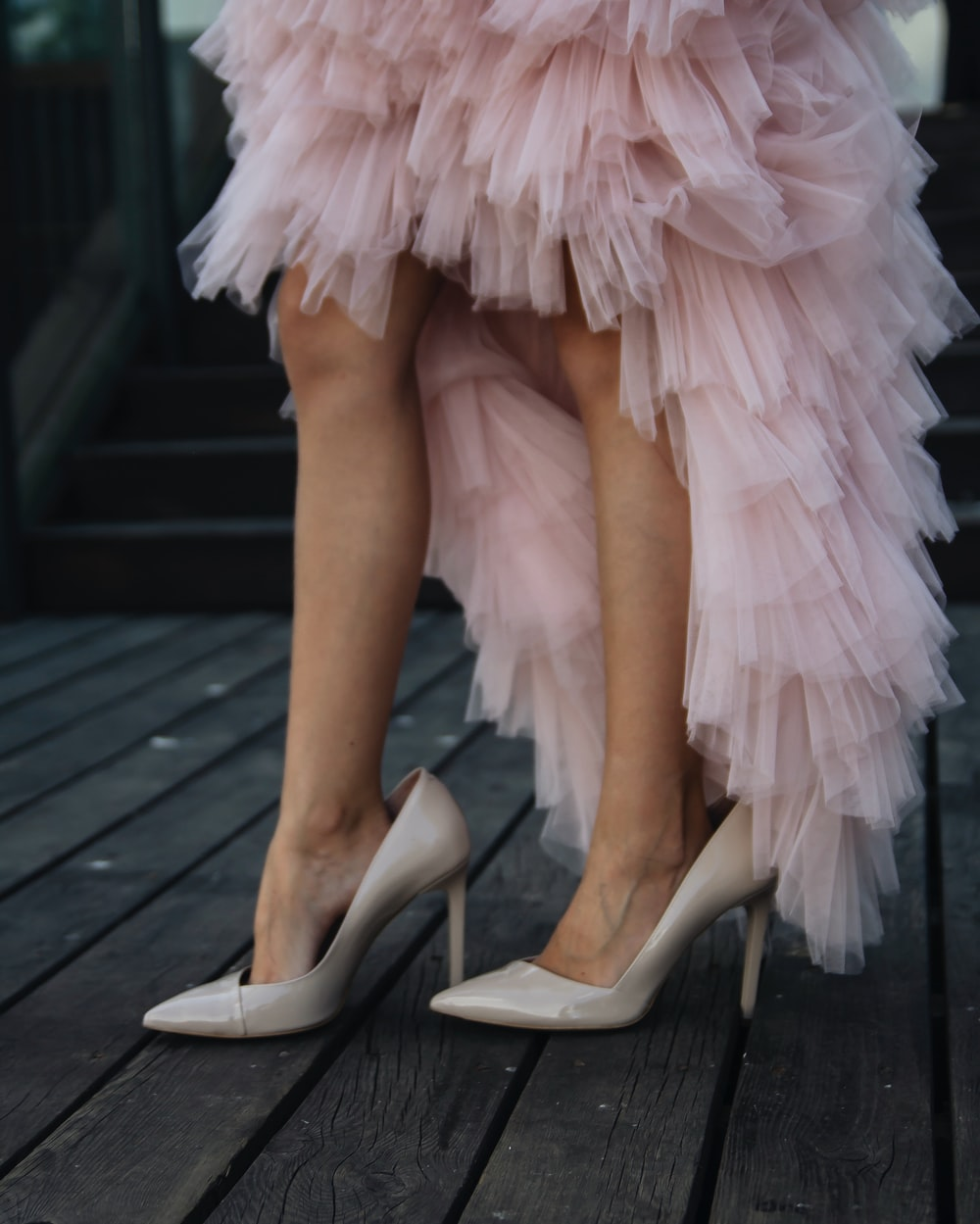 woman wearing pink tulle hem gown