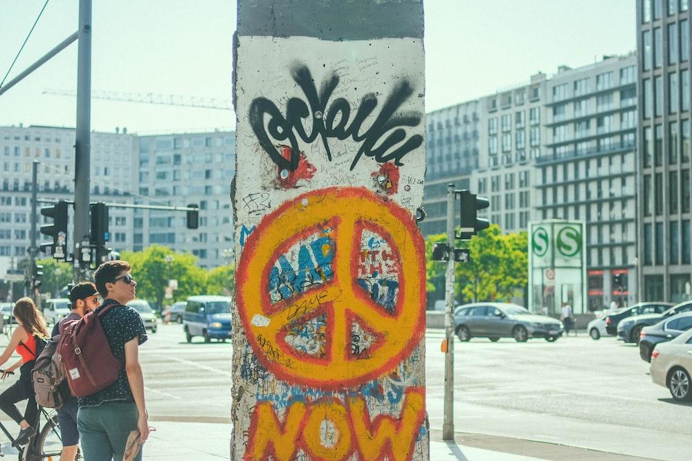 orange peace logo signage
