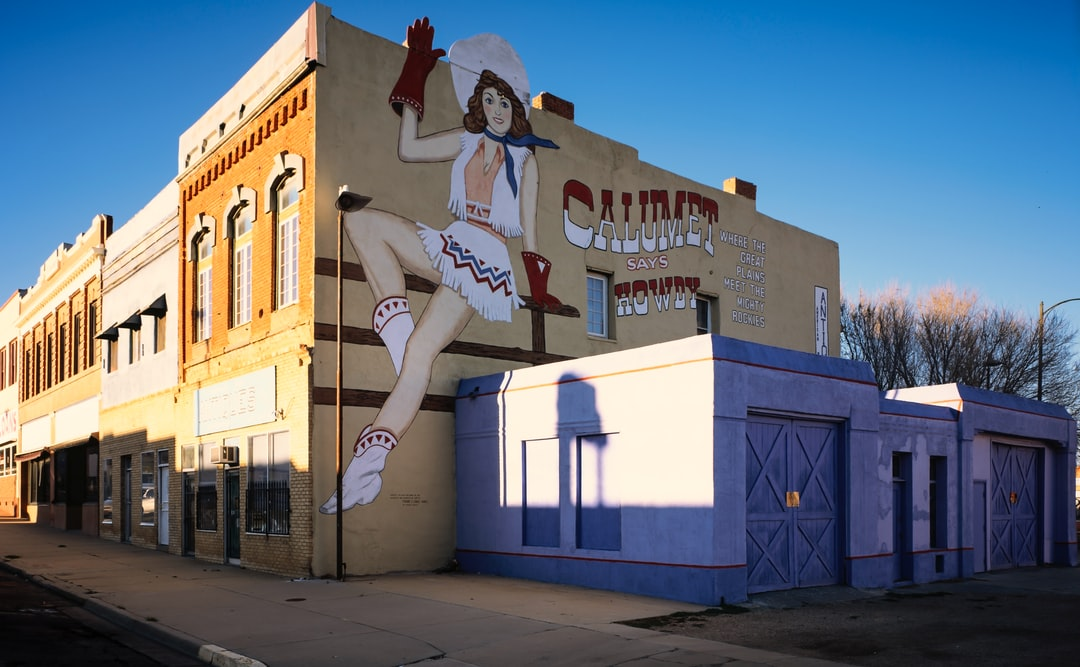 Downtown Las Vegas, New Mexico, has been the backdrop for several films, and one of them was an awful movie 'Red Dawn.' In that movie, the town was called Calumet, and during the night Russian Paratroopers invaded and tried to take over the community, but were warded off by the local kids from the high school. The mural in this shot was painted for the movie and decayed over the years. It got so bad that the town had an artist repaint it and it remains part of Las Vegas history.