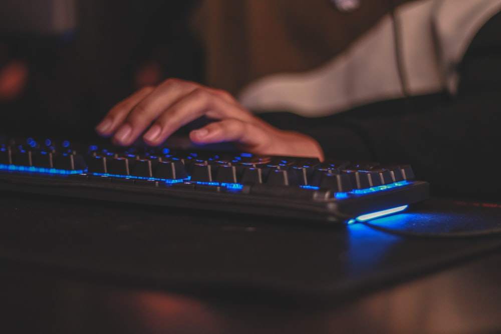 person holding gaming keyboard