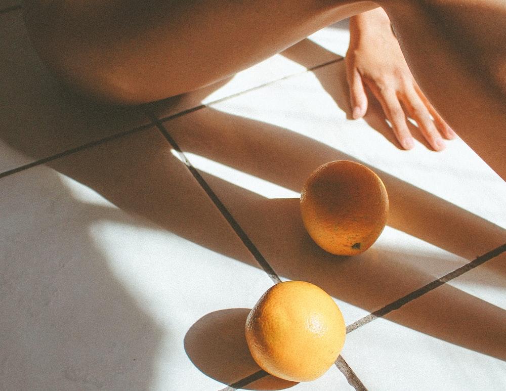 two orange fruits on floor