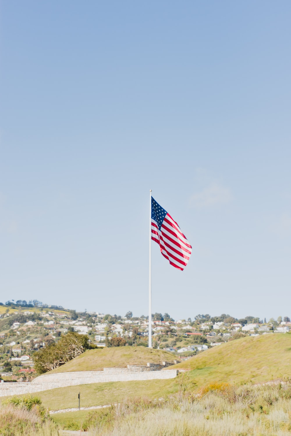 flag of USA near buildings during daytime