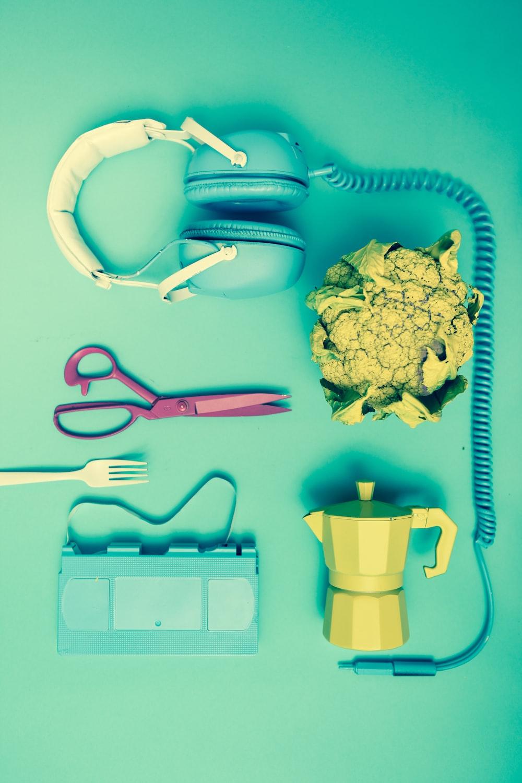 headset, scissor, teapot on table