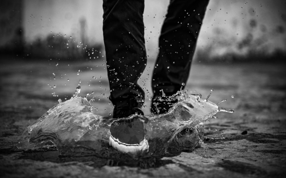 man stepping on water