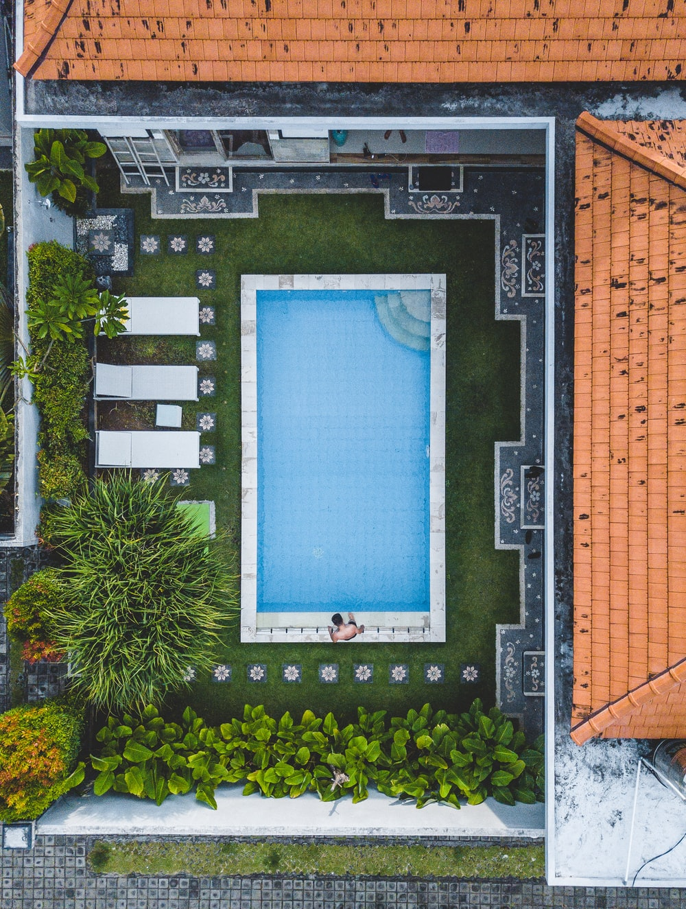 man standing beside pool