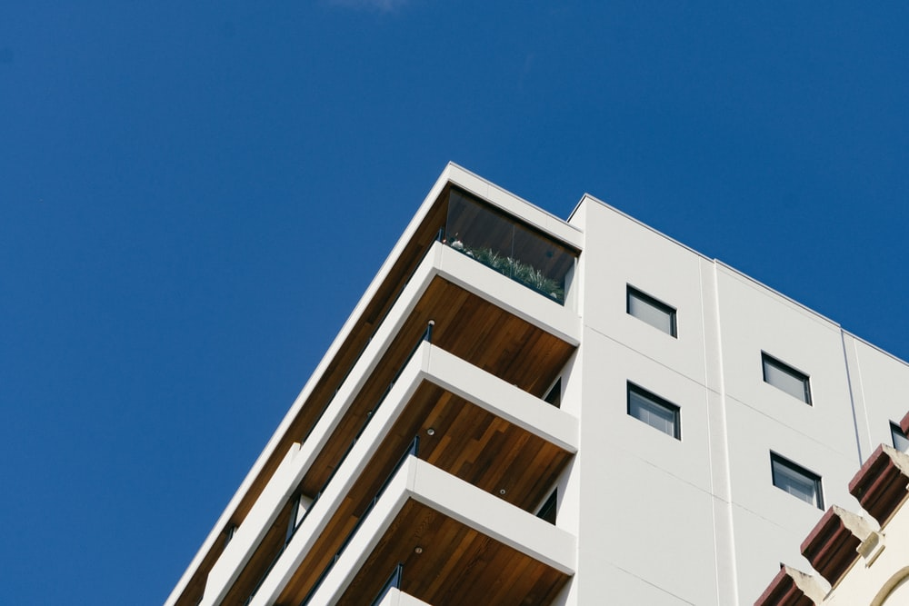 white concrete building with balconies during day