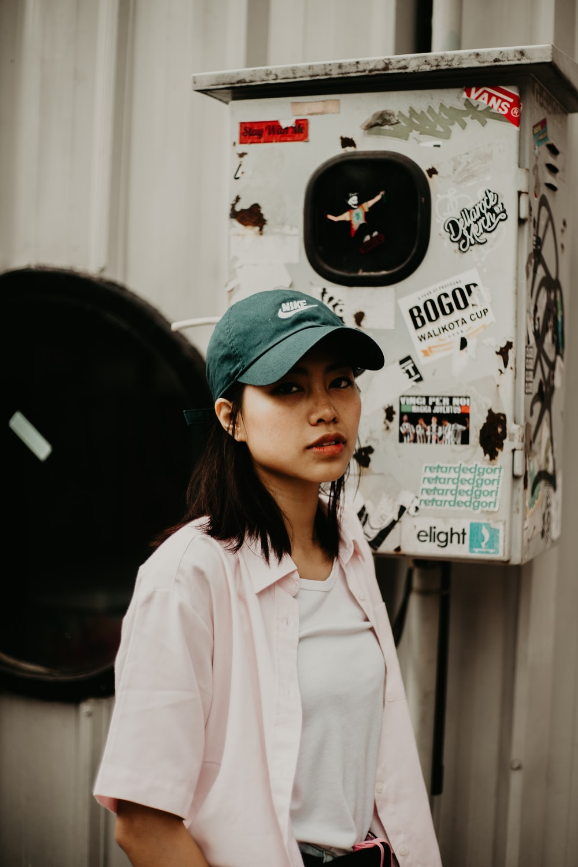 woman wearing green baseball cap