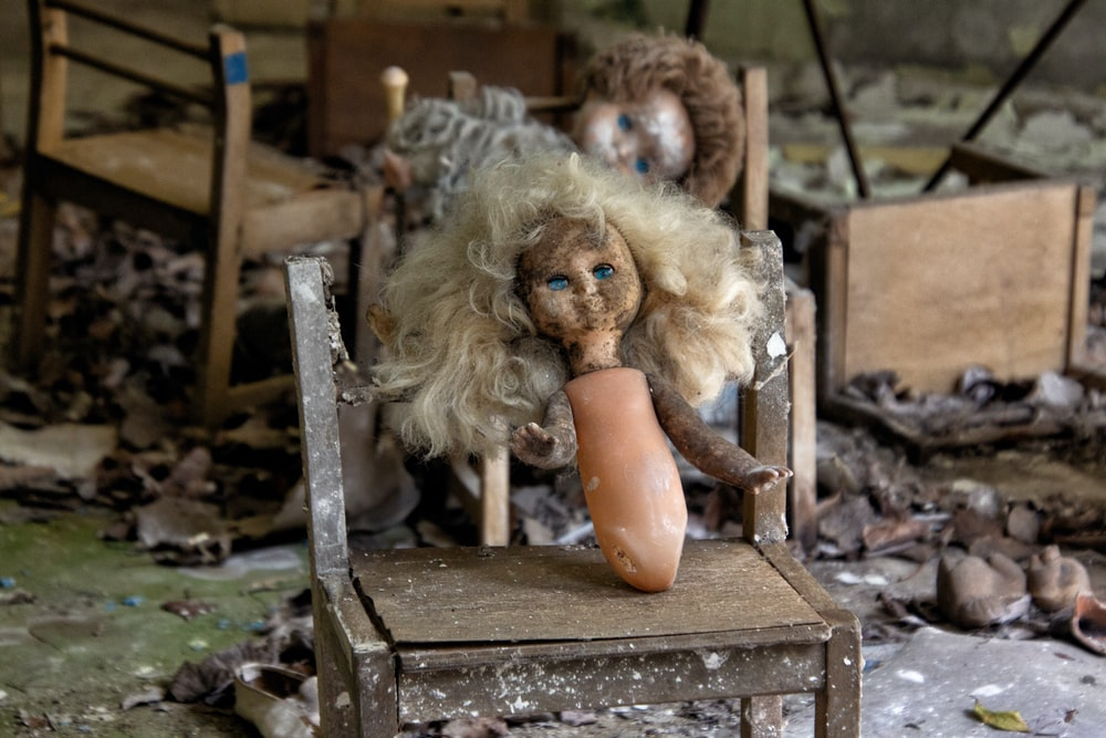doll on brown table