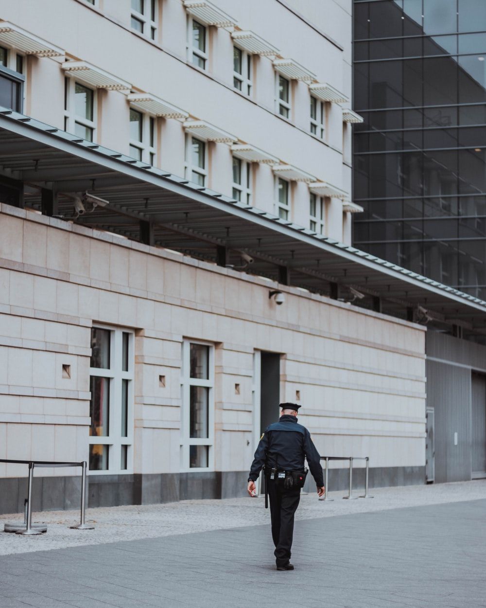 police man walking near building