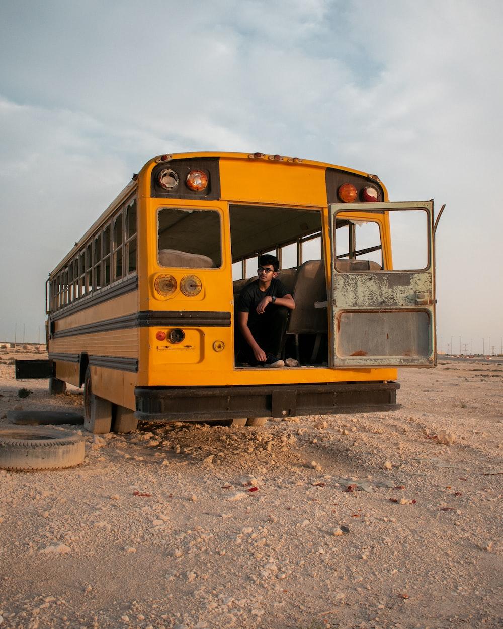 man sitting on school bus