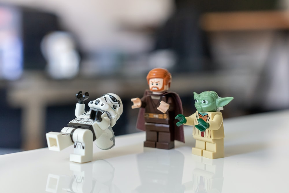 selective focus photo of Master Yoda, Kyro Ren, and Snow Tropper from Star Wars mini figures