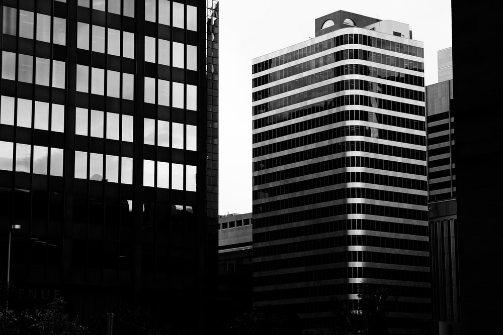 grayscale photogrphy of buildings