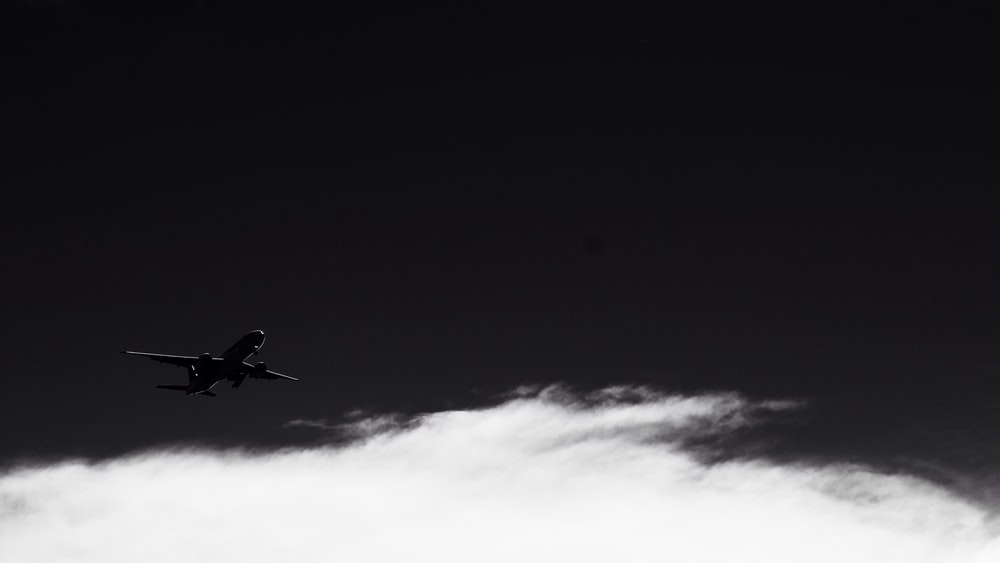 silhouette photo of flying plane