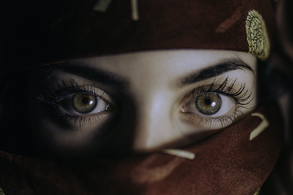 woman face covered with cloth