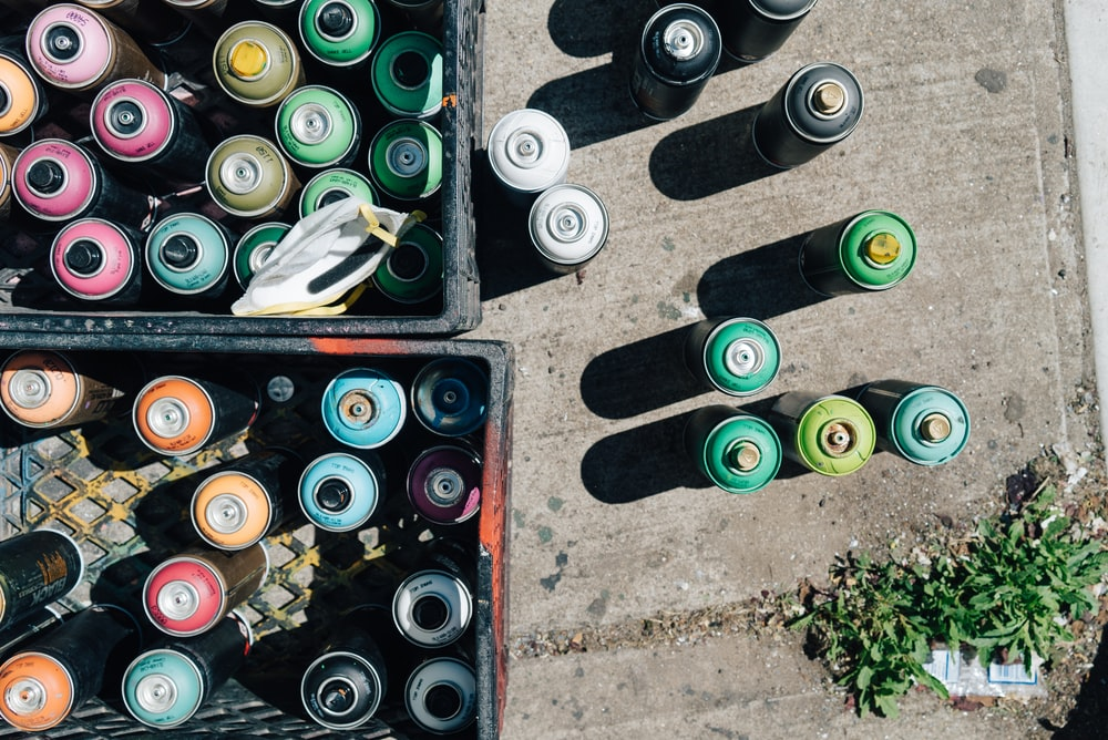 spray can lot on gray pavement