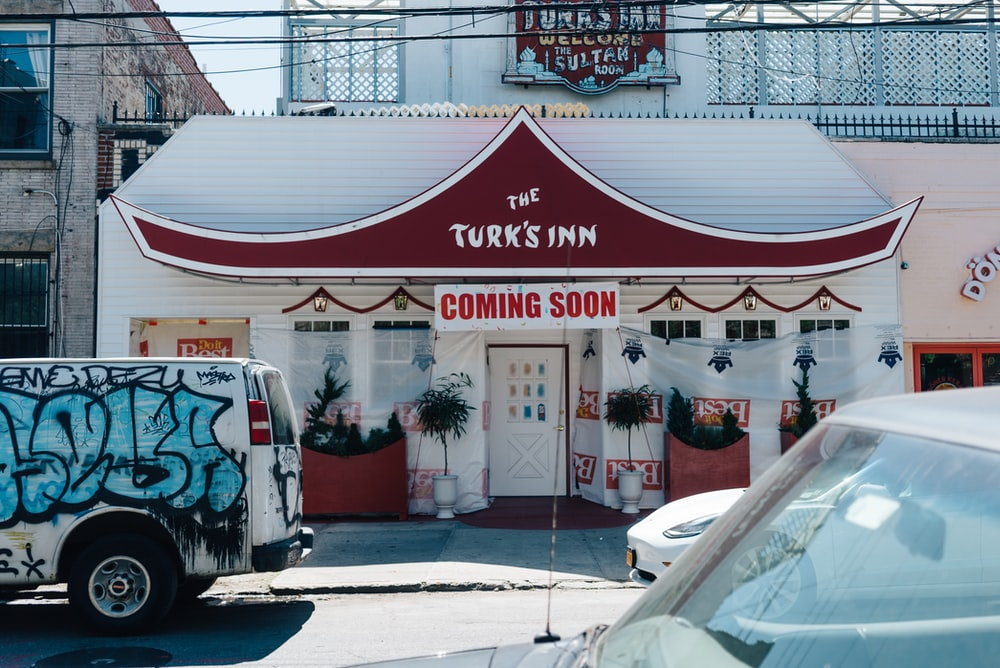coming soon sign on Turk's Inn