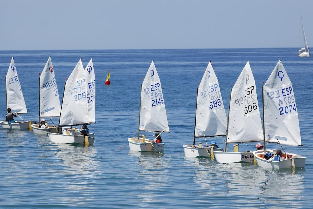 gray boats sailing during daytime