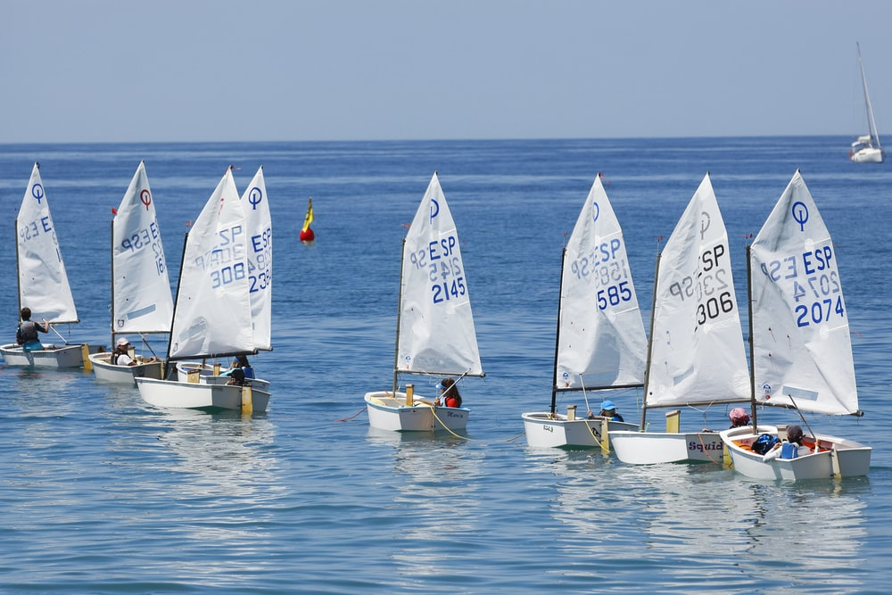 gray boats sailing during daytime
