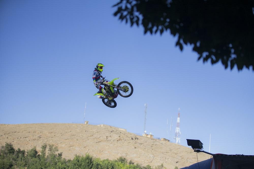 person riding motocross dirt bike