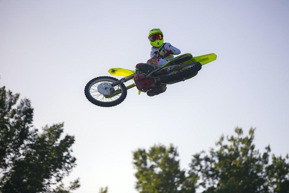man doing motocross tricks on air