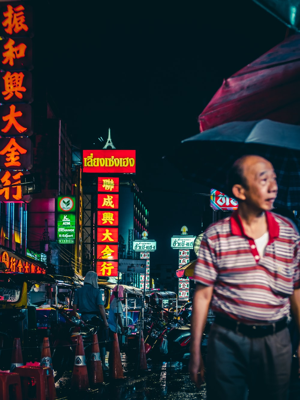 man on road at night