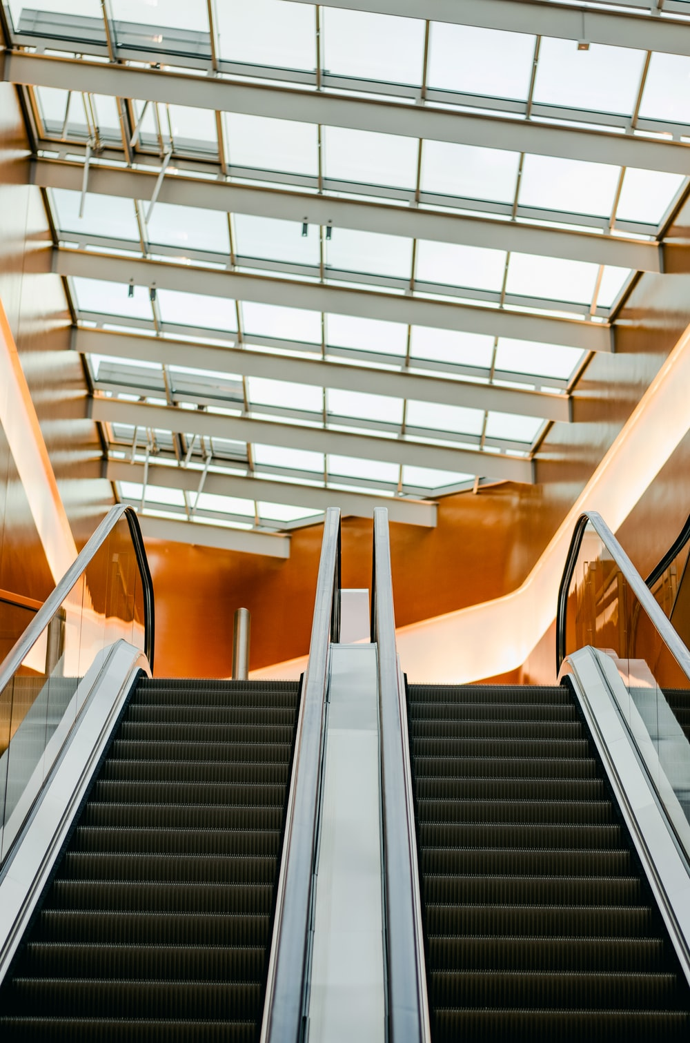 structural photography of escalators