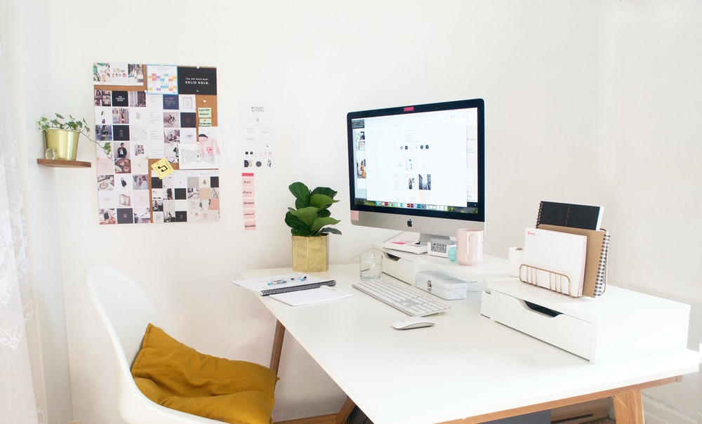 silver iMac on table