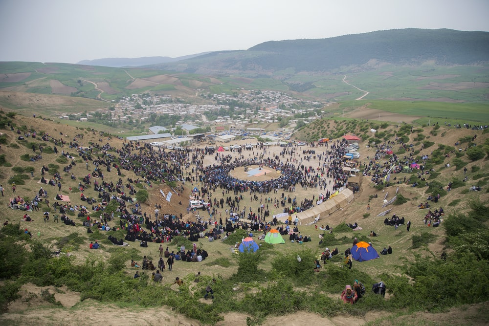 people gathering near mountain