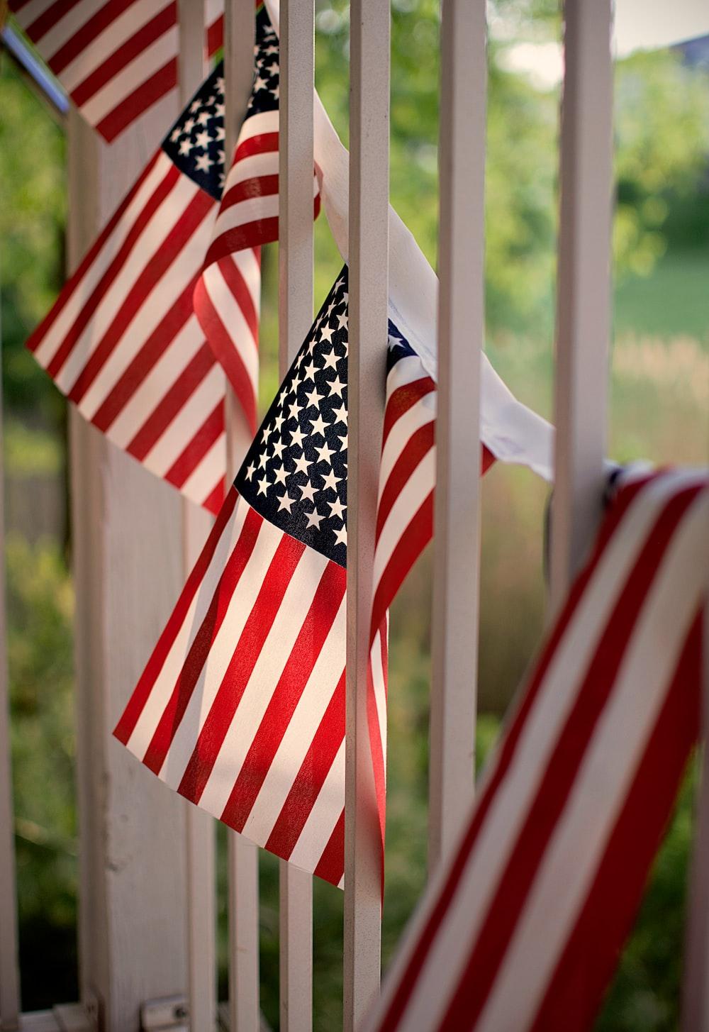 four USA flags
