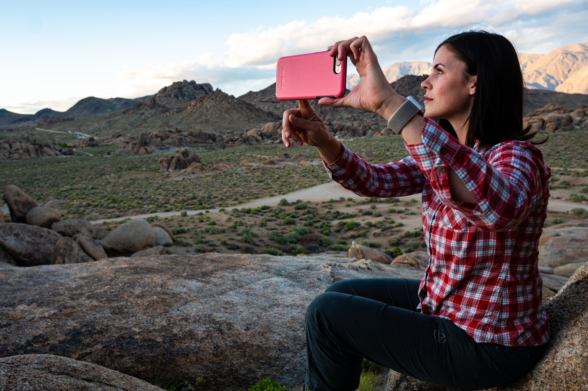 Beautiful woman/wife taking selfie with iPhone while hiking in the rocks of Alabama Hills, Ca. I love watching my wife take photos of herself .