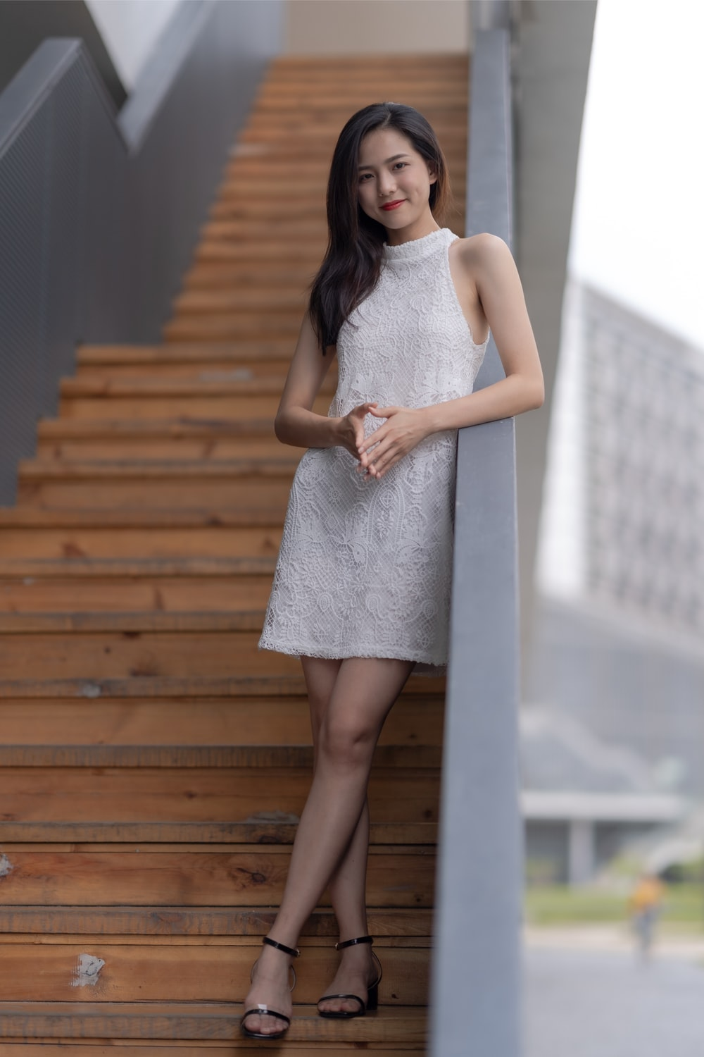 woman standing on stairs