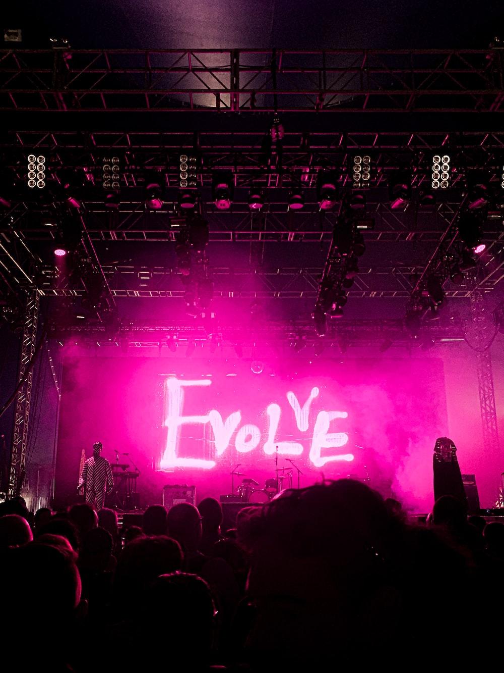 pink Evolve stage neon signage