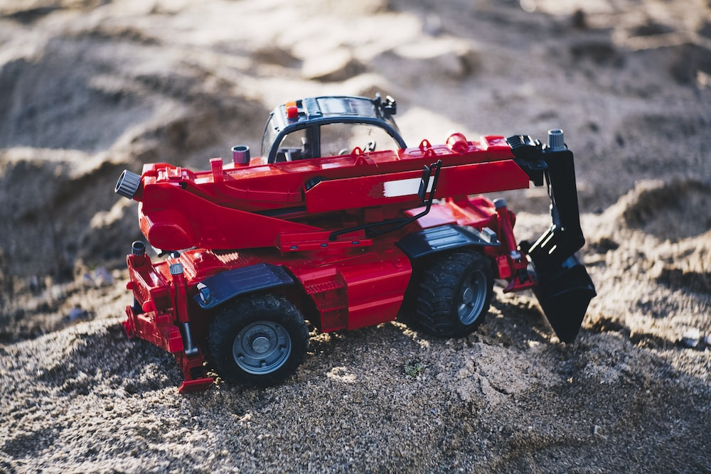 red and black heavy equipment oty