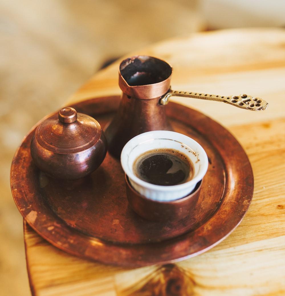 moka pot and ceramic teacup on tray
