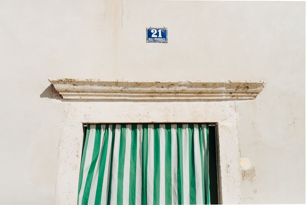 green and white-striped curtain