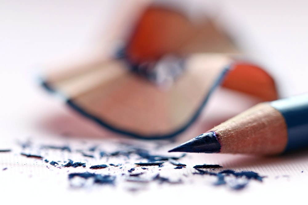 selective focus of blue colored pencil