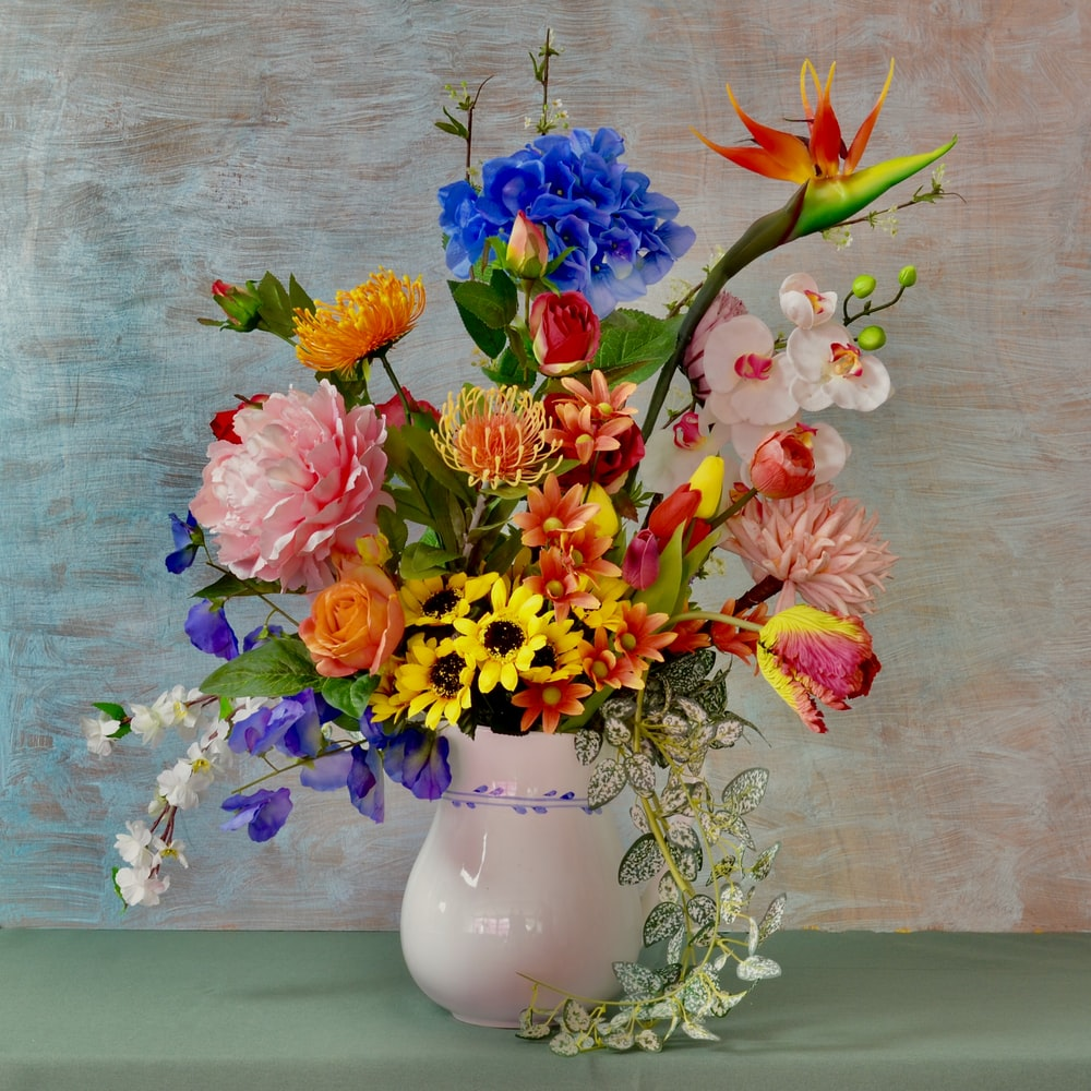 assorted flowers in white vase