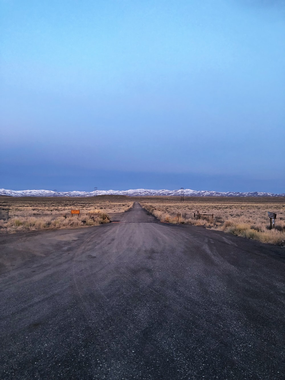 dirt road and mountains at the distance during day
