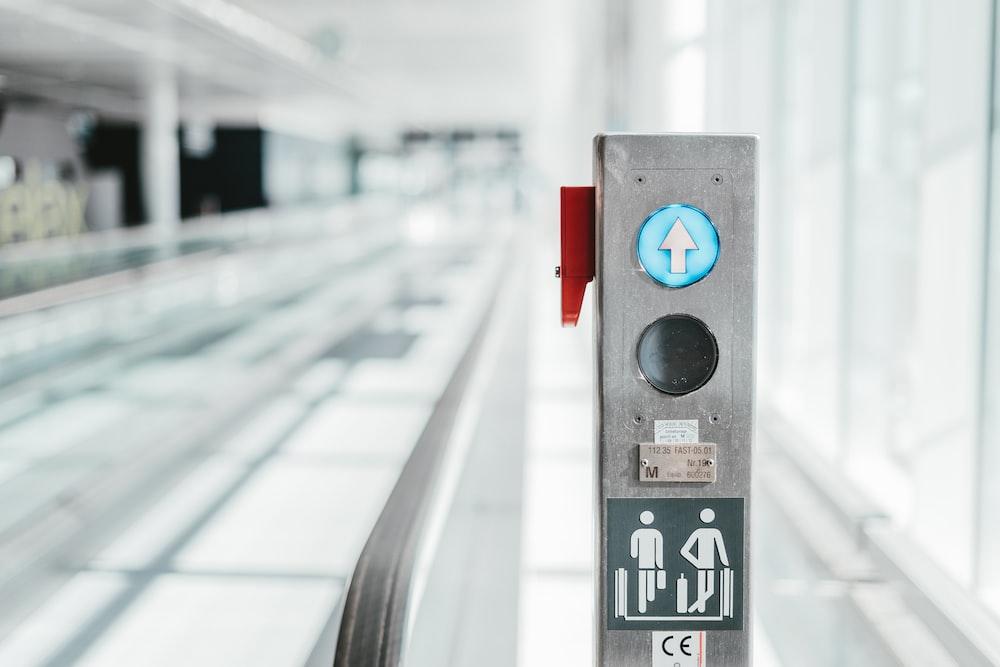 selective focus photo of escalator button