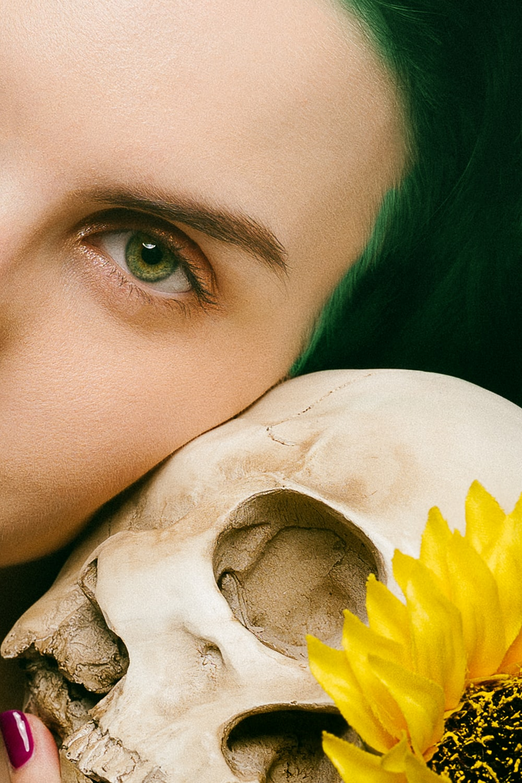 woman taking selfie with skull