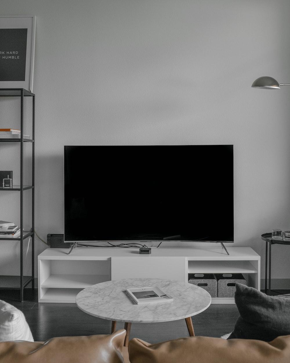 flat screen TV displaying black screen