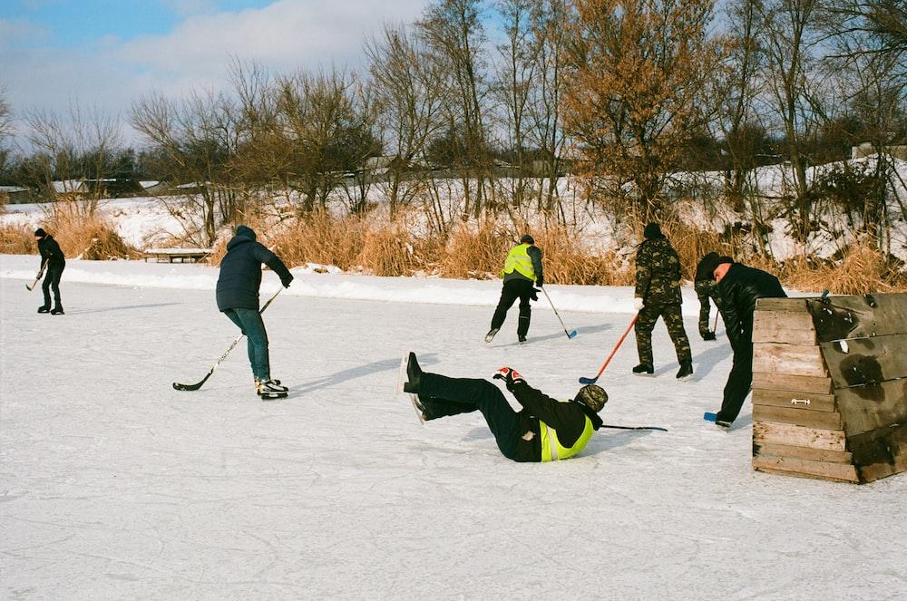 people skating on field