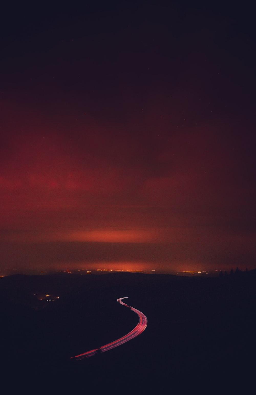 road under grey clouds