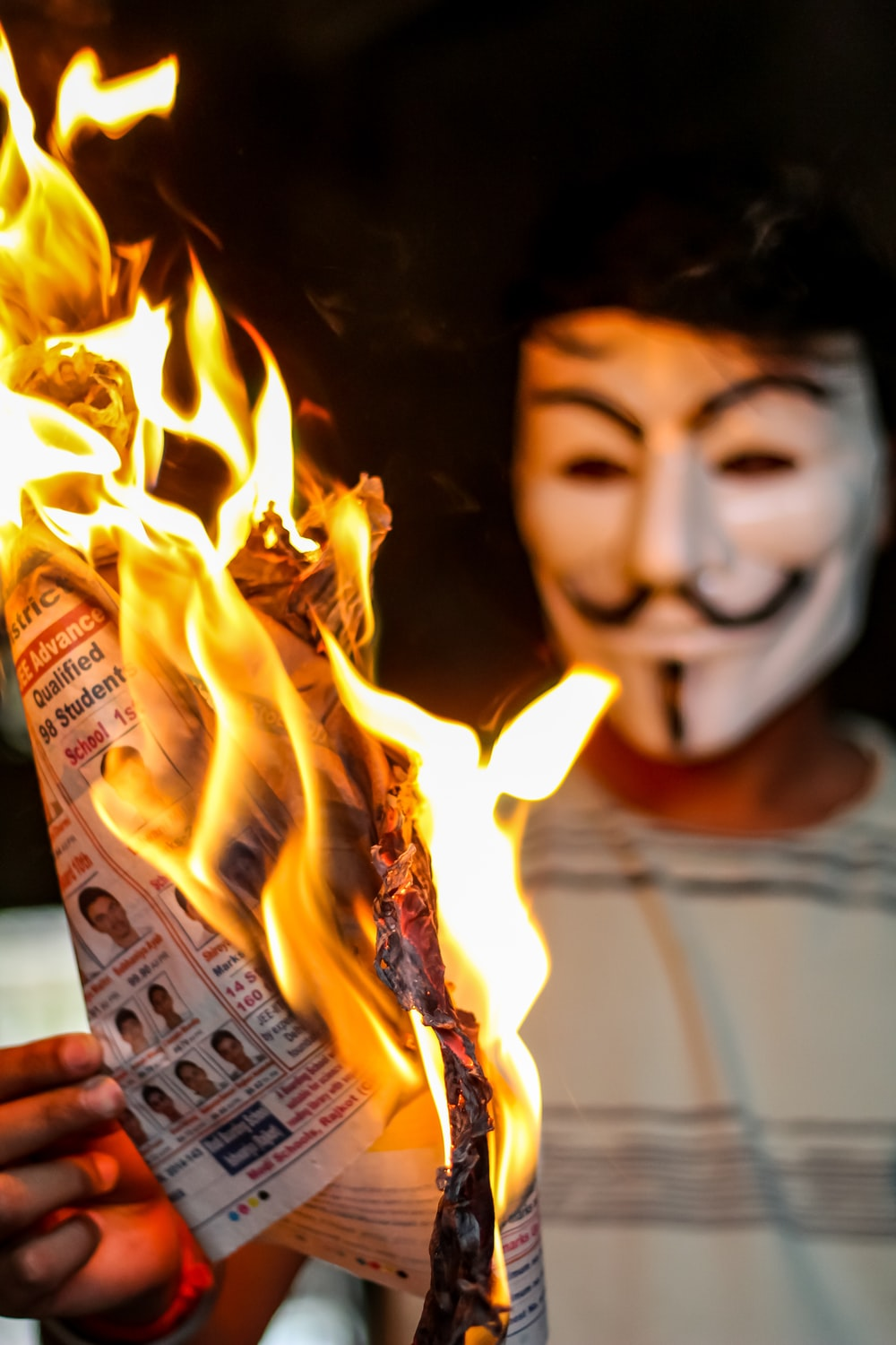 person holding flamed paper