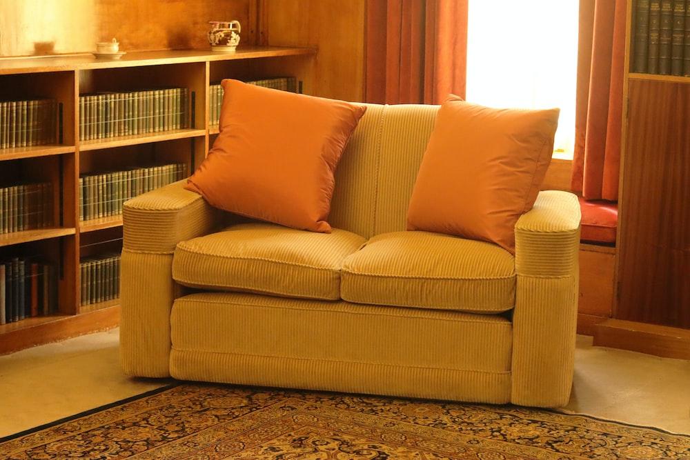 brown 2-seat sofa