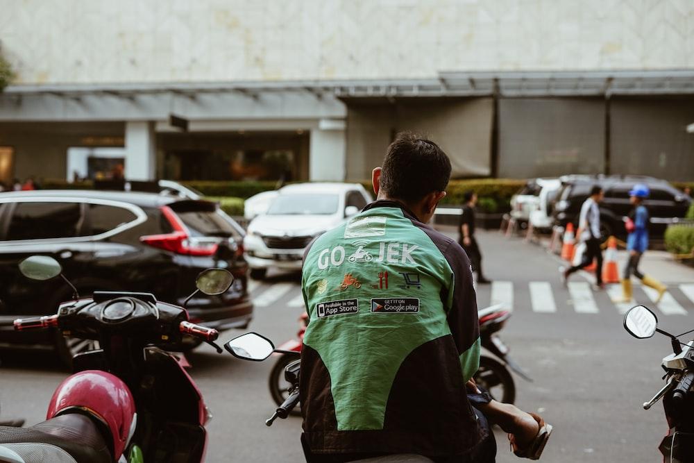 man sitting on motorcycle